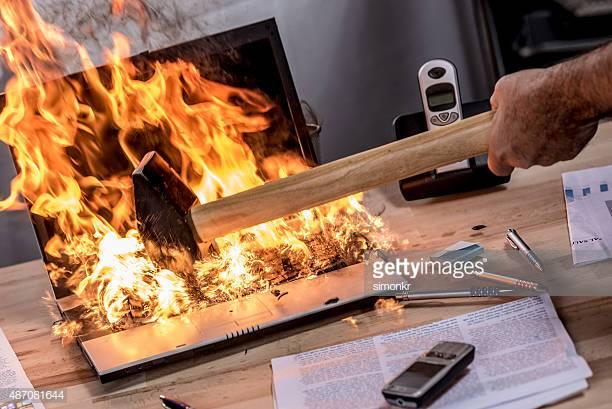 burning_laptop_hammer.jpg