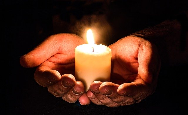 grief_mourning_hands_with_candle